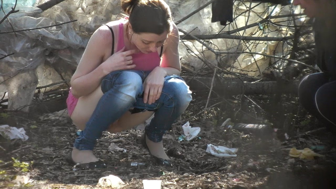 Girls peeing outdoors video clip