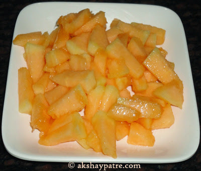 chopping muskmelon - preparing kharbuja rasayana
