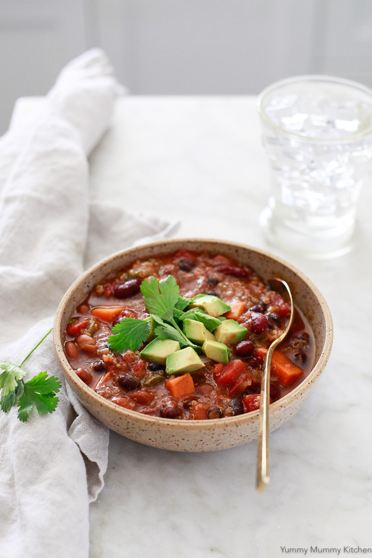 A delicious bowl of vegetarian and vegan chili made with beans, quinoa, and sweet potato. This chili was made in the Instant Pot.