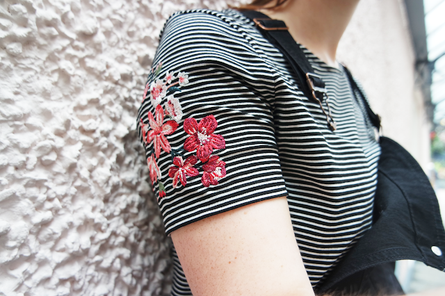 pink and red flowers embroidered on a stripy t shirt