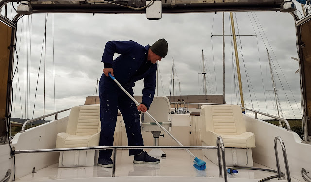 Photo of scrubbing the deck of the fly bridge
