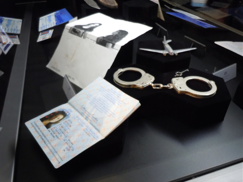 Kate handcuffs and passport LOST props
