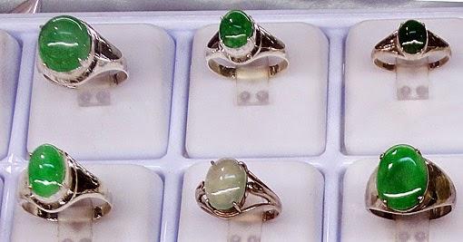 Jade rings in white gold settings