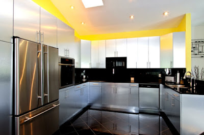 U kitchen design with black floor to highlight the design