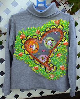 Arte para vestir de la mano de Talentox2 Moda con sus camisetas pintadas de haditas, originales diseños.