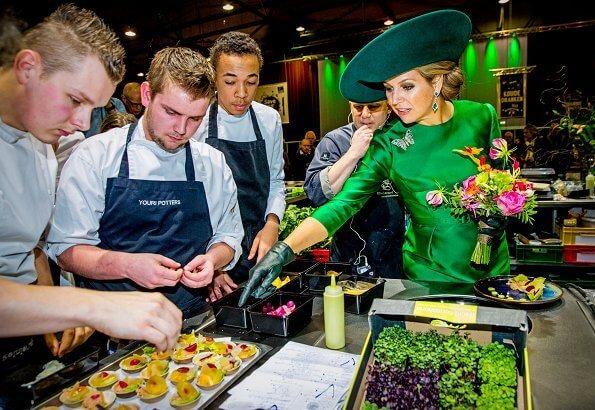 2018 Dutch Organic Trade Fair at IJsselhallen Convention Center in Zwolle. Queen Maxima wore Natan dress and Natan shoes, green diamond earrings