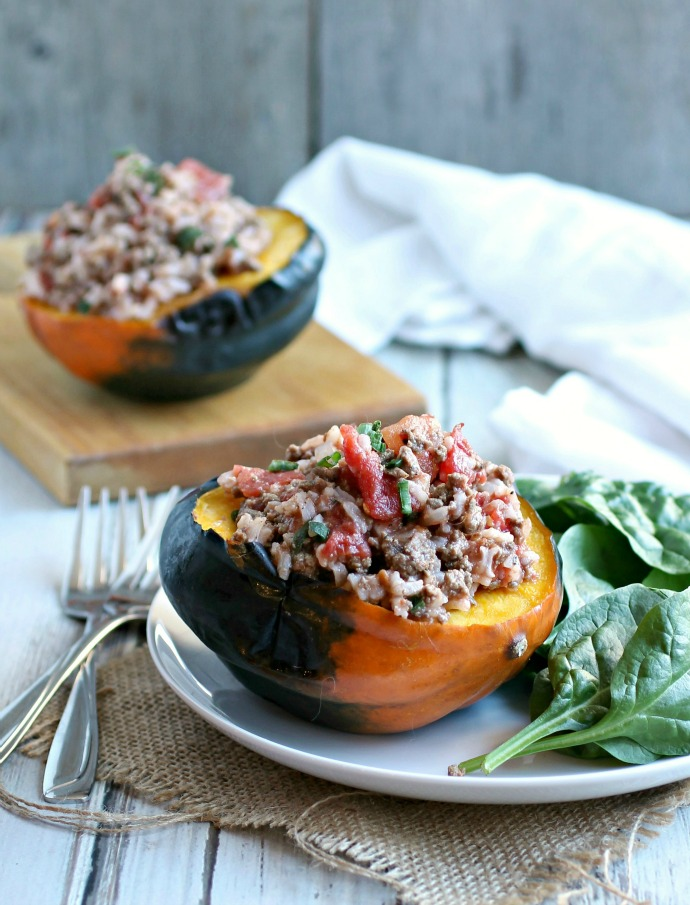 Recipe for a quick chili made with ground beef, rice and diced tomatoes served over roasted acorn squash.