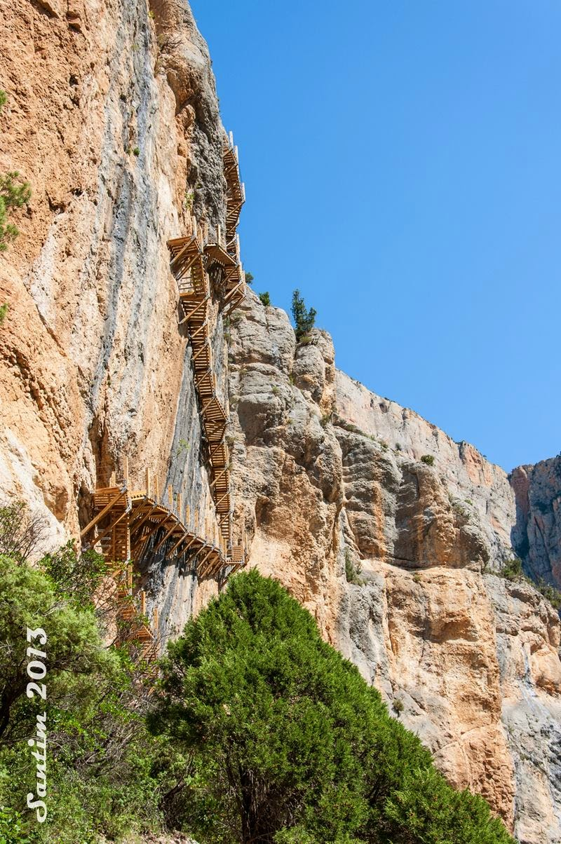 A path with steps excavated in rock, hanging bridges and vertigo walkways is natural route from  Montfalcó in Huesca to reach Sierra del Montsec gorge