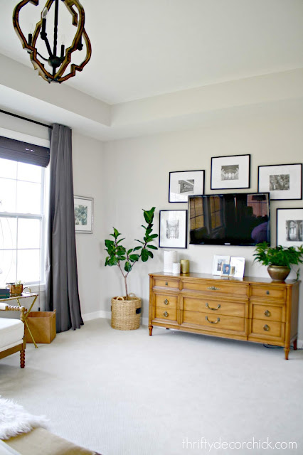 TV in bedroom with gallery wall