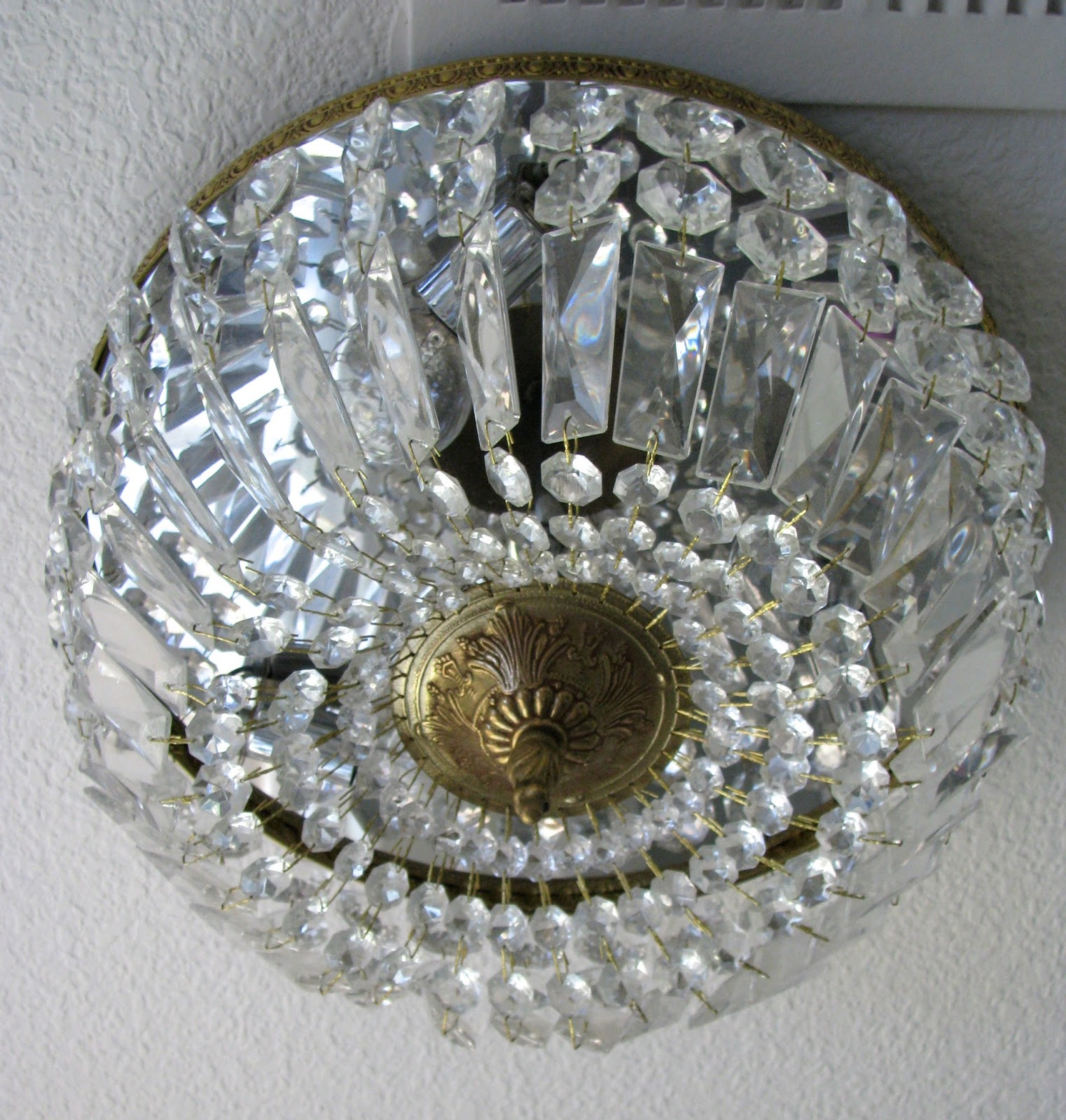 It Is A Flush Mount Gold And Crystal Light Fixture That Holds Three Bulbs Has Mirrored Top Puts Off Such Pretty Bright