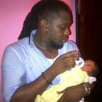 timaya+feeding+baby