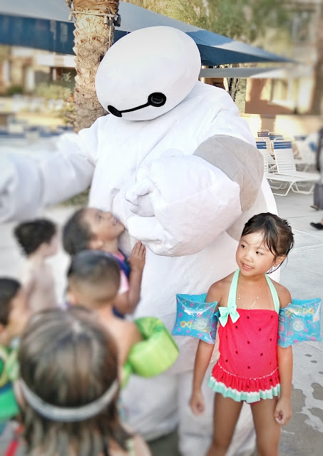 Marriot Shadow Ridge, Palm Desert in the Enclaves pool meet and greet with Baymax during the dive-in movies night.