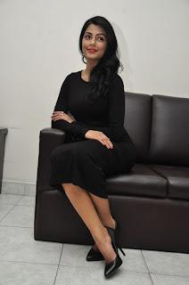 Actress Anisha Ambrose Stills in Black Dress at Run Movie Press Meet  0096