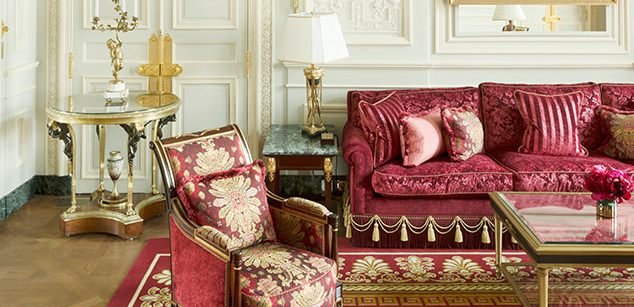 Burgundy sofa and chair in renovated guest suite Ritz Paris