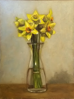 Oil painting of a bunch of daffodils in a 1 litre glass carafe