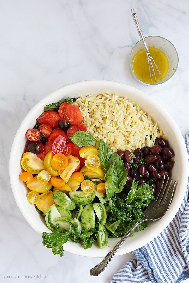 This beautiful vegan salad is filled with kale, tomatoes and orzo. Add chickpeas or pine nuts for extra protein. This colorful kale salad is perfect for meal prep or parties.