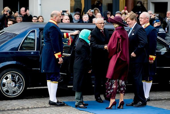 Dutch Queen Maxima wore Natan coat and Natan Pumps and she wore Saloni floral satin dress