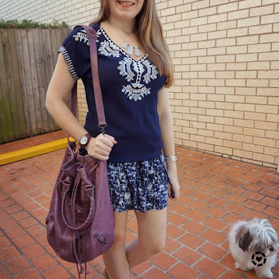 awayfromblue instagram embroidered navy tunic monochrome outfit with printed shorts Balenciaga pompon bag