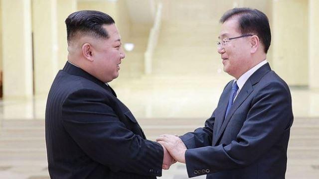 Kim Jong-un shakes hand with Chung Eui-yong, head of South Korea's delegation