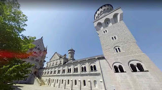 Neuschwanstein Castle is a palace on a rugged hill