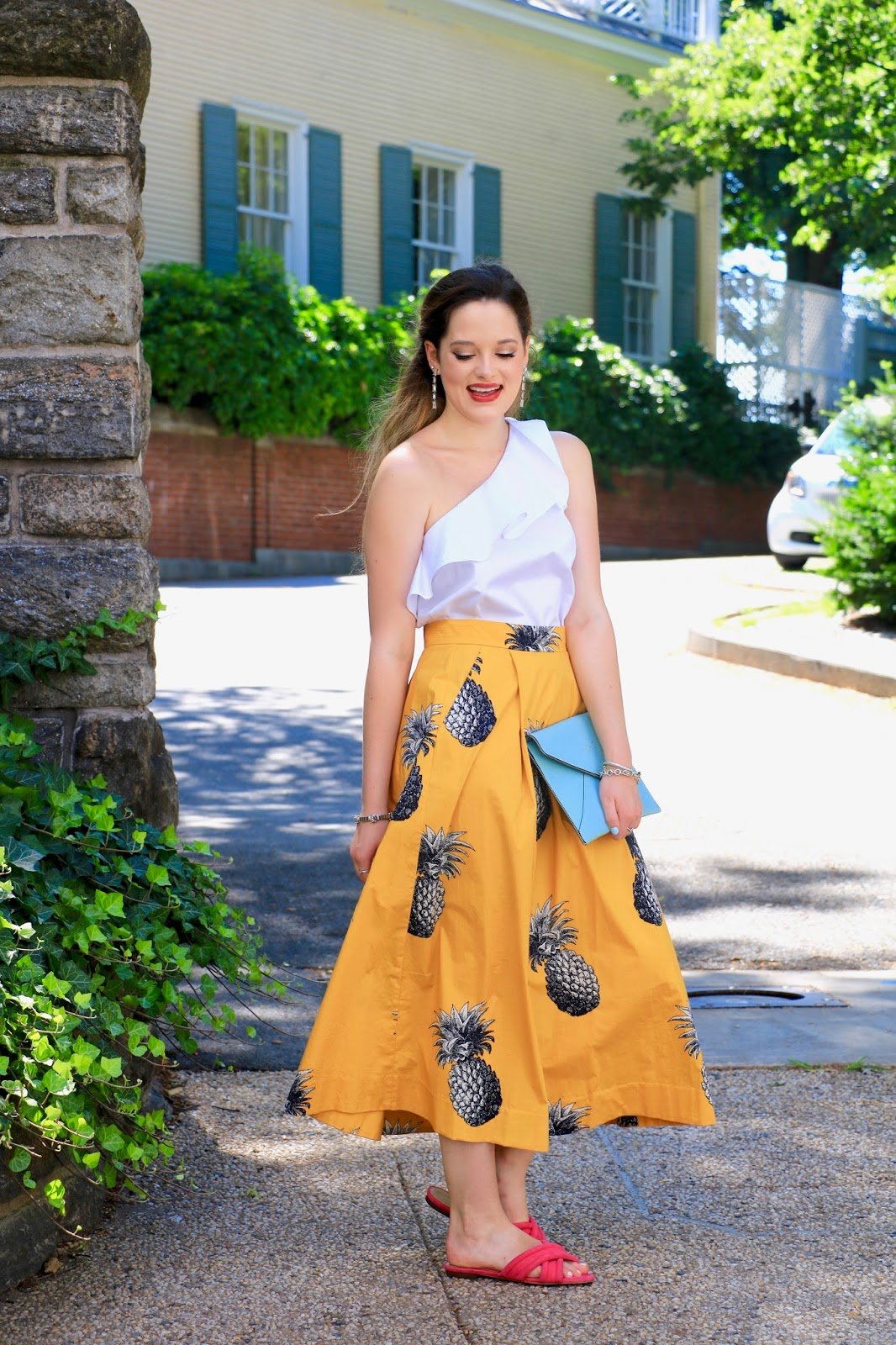 nyc fashion blogger Kathleen Harper wearing a pineapple skirt with ruffle one-shoulder top