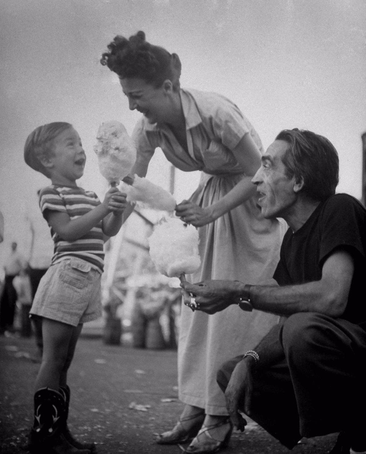 Gypsy Rose Lee gives her son, Erik, cotton candy while her husband Julio De  Diego watches, 1949.