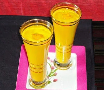 pour the mango lassi in serving glasses