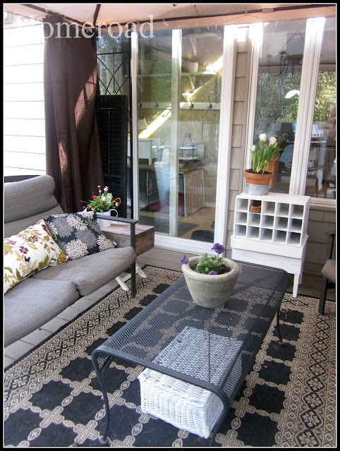 Outdoor furniture, rug and coffee table.