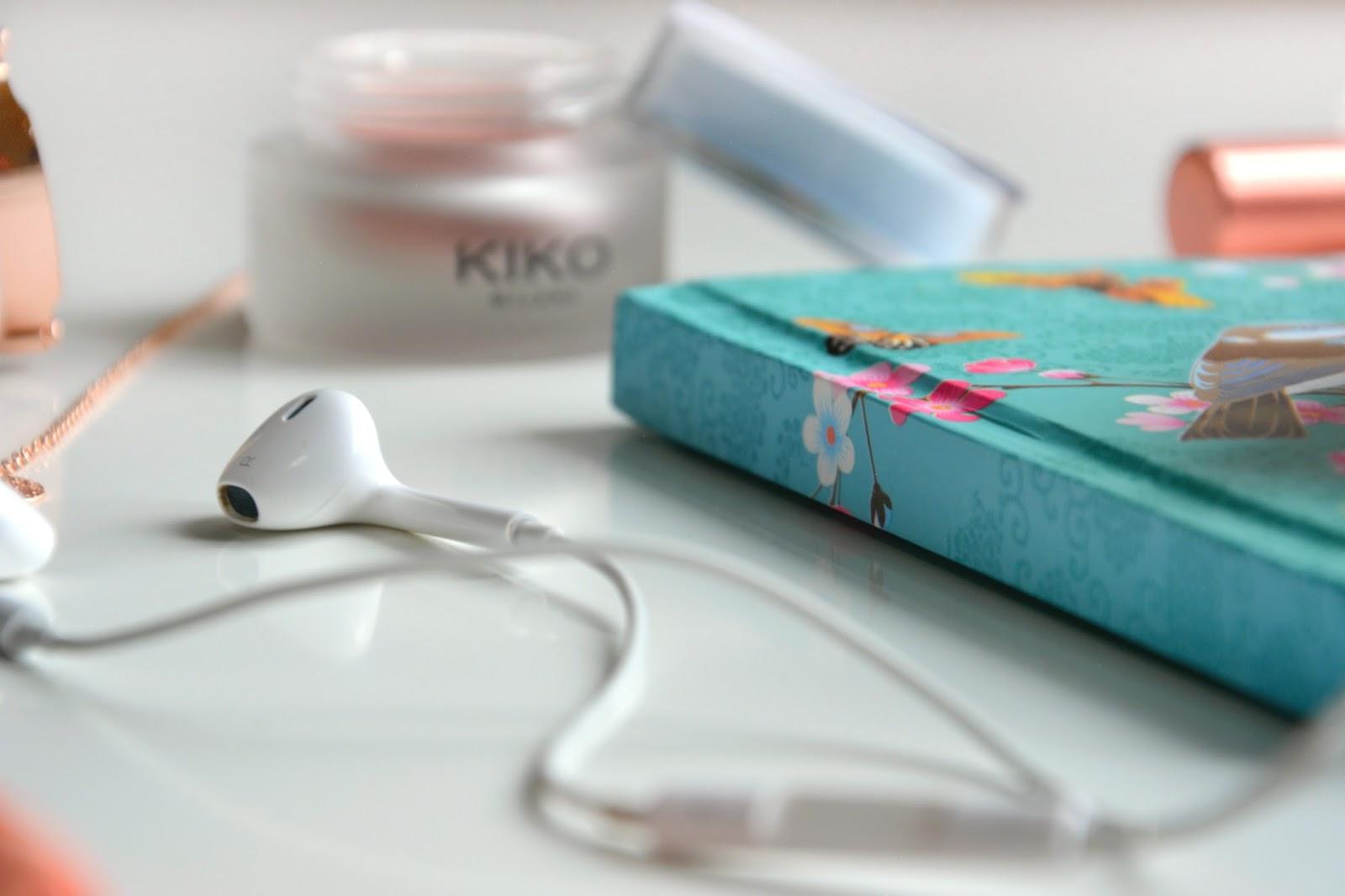 Apple EarPods; Kiko Less Is Better Cream Blush; notebook