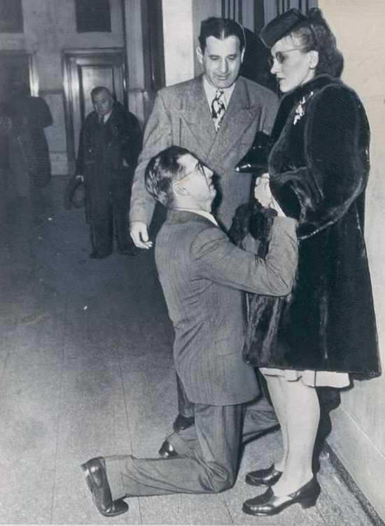 A man begging for his wife's forgiveness inside Divorce Court. Chicago, 1948. femdom bdsm kink