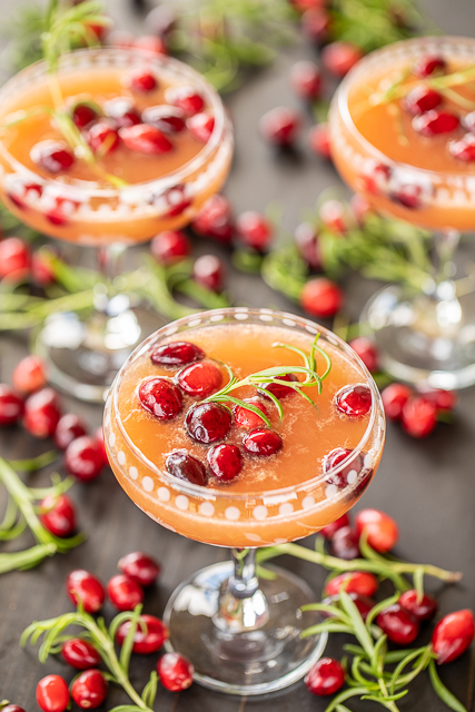 Jolly Juice - cranberry and citrus/orange mimosa. Only 3 ingredients! Great for parties and brunch. We love to make a batch for Christmas morning! Cranberry juice, 5-Alive and champagne. SO light and refreshing. #mimosa #champagne #cocktail #christmas