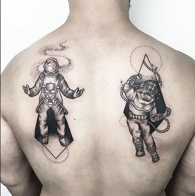space astronaut back tattoo