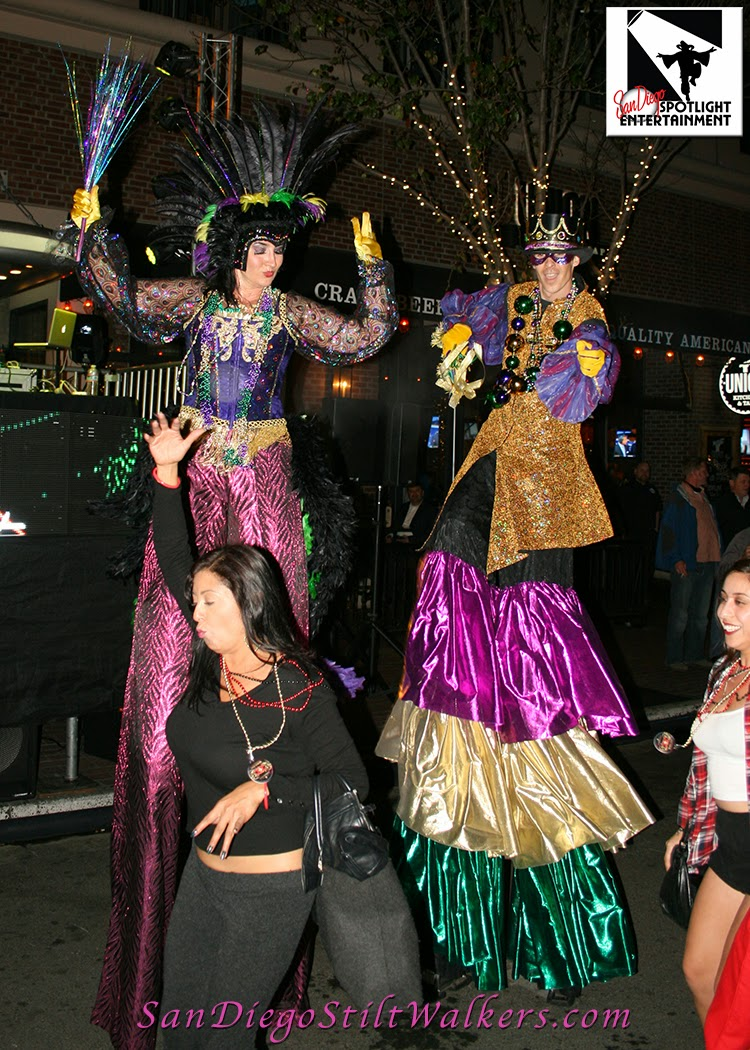 San Diego Mardi Gras Party stilt walkers Gaslamp