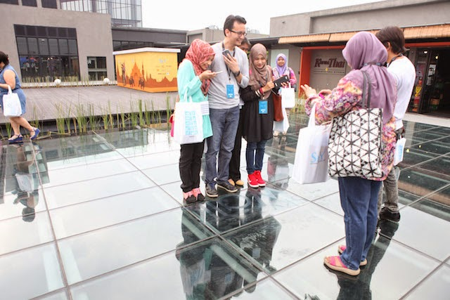 Bloggers at the launch event, enjoying the see through floor of The Sky, One City Mall