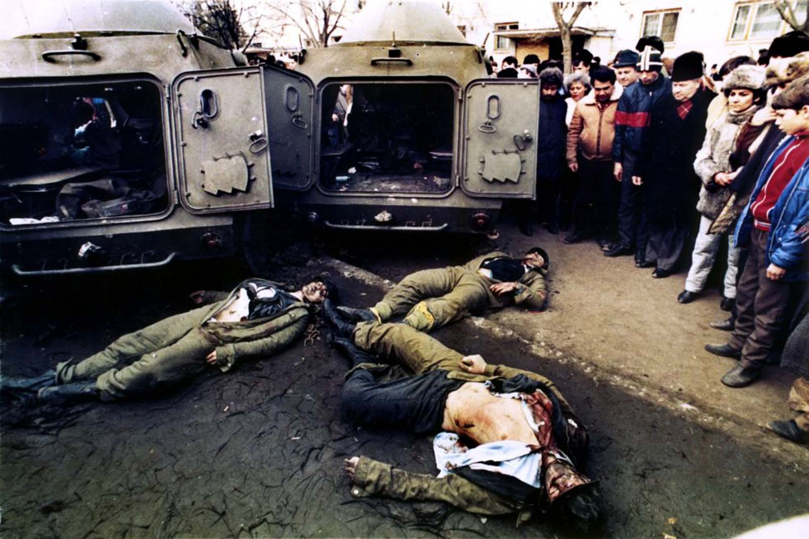 Members of special troops lie dead in front of their armored vehicles after being shot by the army in the Bucharest suburb of Taberei.