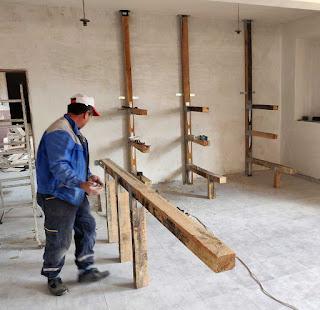 Bekir finishing the basic parts of the wood store