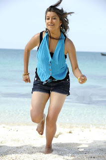 Telugu Actress Madhurima Pictures at the Beach Exposing her Smooth Legs