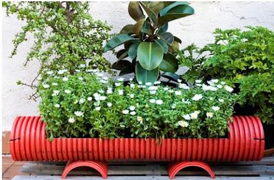 cómo hacer una jardinera utilizando un tubo grande, como hacer una jardinera fácil para poner en el patio
