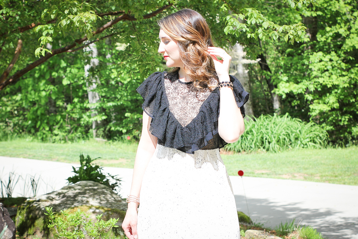 Laura Mintz of Illuminate Blog Styles a Classic Black and White Lace and Pleated Midi Dress from Chicwish