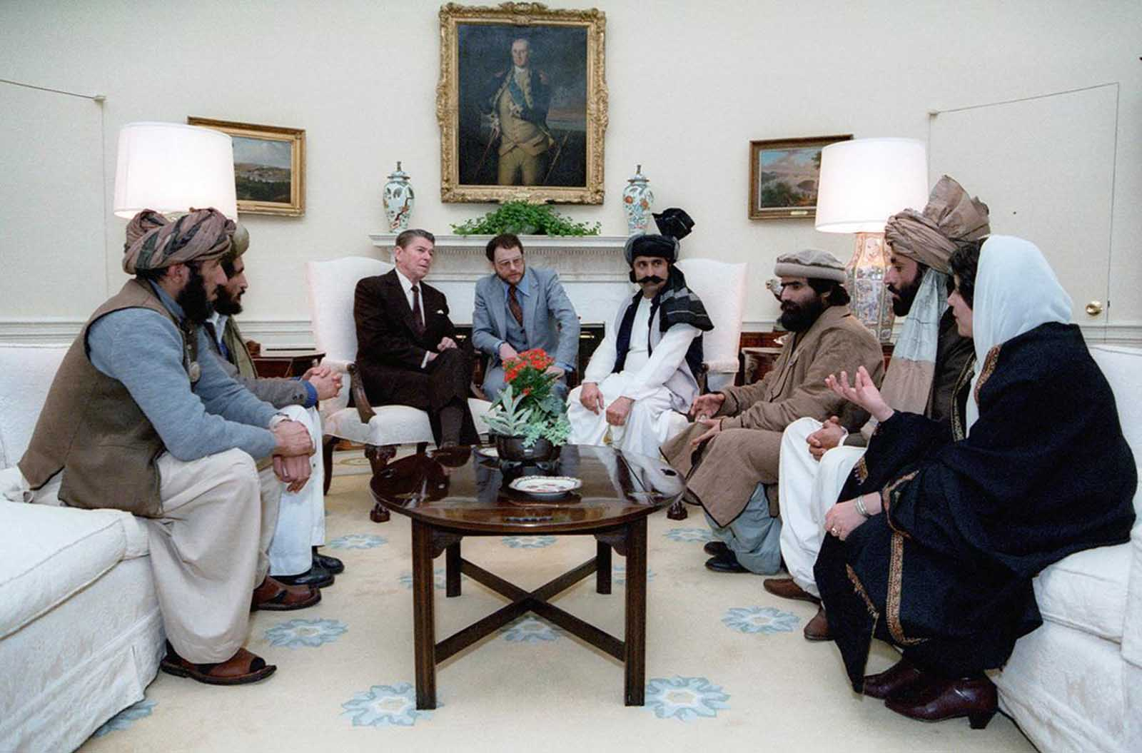 U.S. President Ronald Reagan meets with a group of Afghan freedom fighters to discuss Soviet atrocities in Afghanistan, especially the September 1982 massacre of 105 Afghan villagers in Lowgar Province.