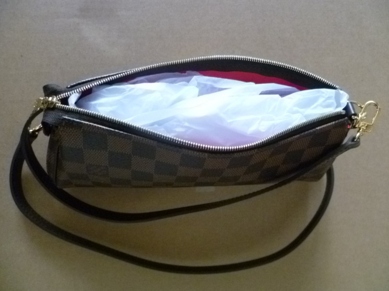 0d82792cf0b9 Make sure when you are not using your bag to stuff it to keep its shape.  This prevents the handbag from getting warped or loose its shape.