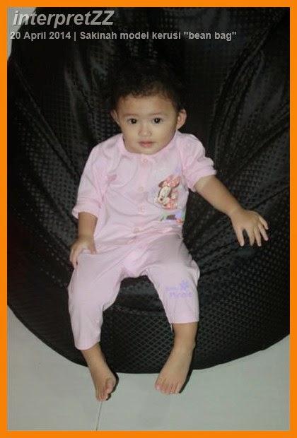 Baby Sakinah relaxing on black bean bag chair at Sepang, Selangor, Malaysia.