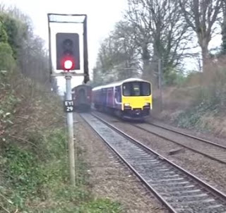 If this Class 150 Sprinter had been 30 seconds faster it would've ruined the view for the trainspotters on the other platform!