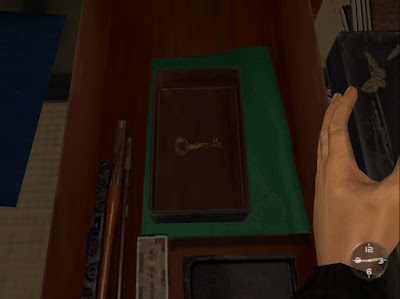 The small box in Iwao's room that contains a key.