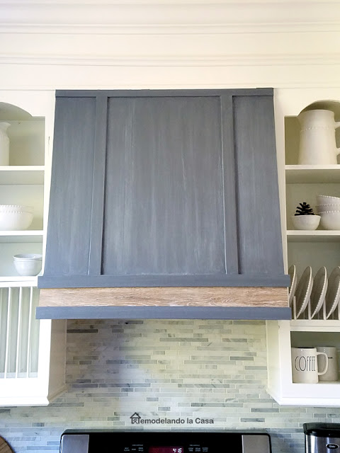 grey and white kitchen makeover with range hood