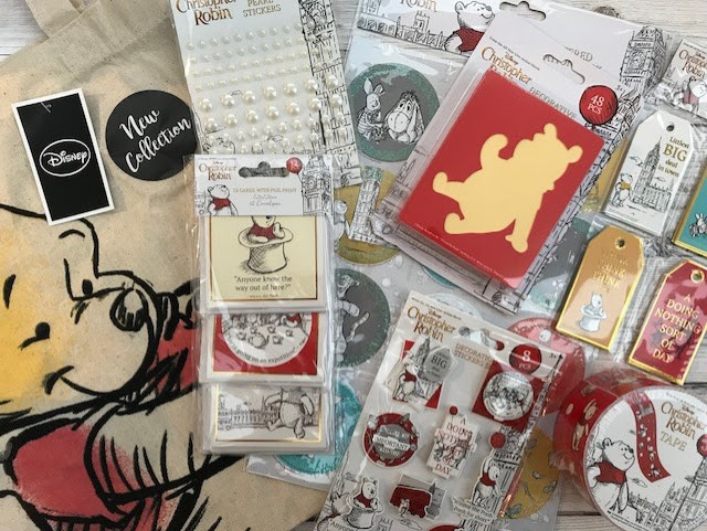 A Winnie the Pooh canvas bag and a selection of craft items, including tags, stickers and tape