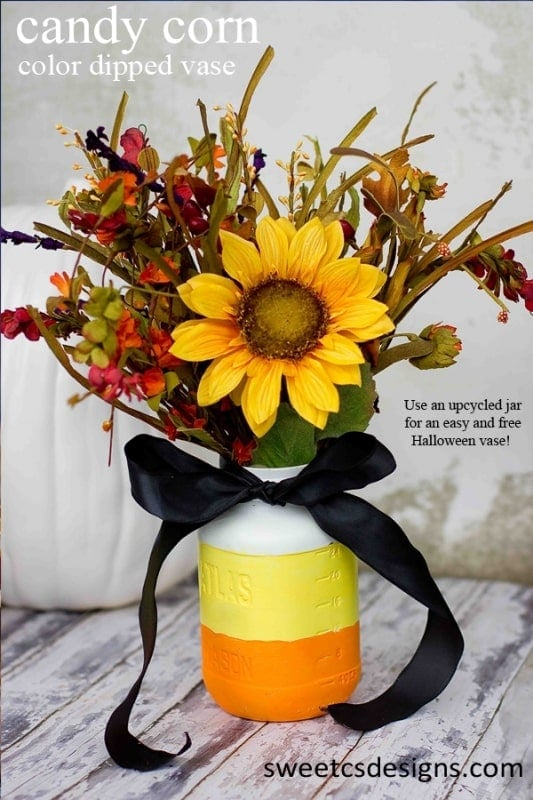 25 awesome ways to use mason jar on Halloween. Halloween candy corn color dipped vase. Beautiful Mason jar for candy and treat bar on Halloween. Best Halloween Mason jar craft ideas. Halloween Mason jar candy craft and gift ideas. Mason jar decoration ideas for treat and candy. Halloween decorative Mason jar. Halloween Mason jar gift ideas. Mason jar for gifts and decoration.