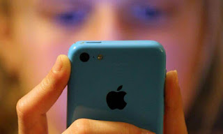 Apple speculators bring for activity over iPhone 'dependence' in kids