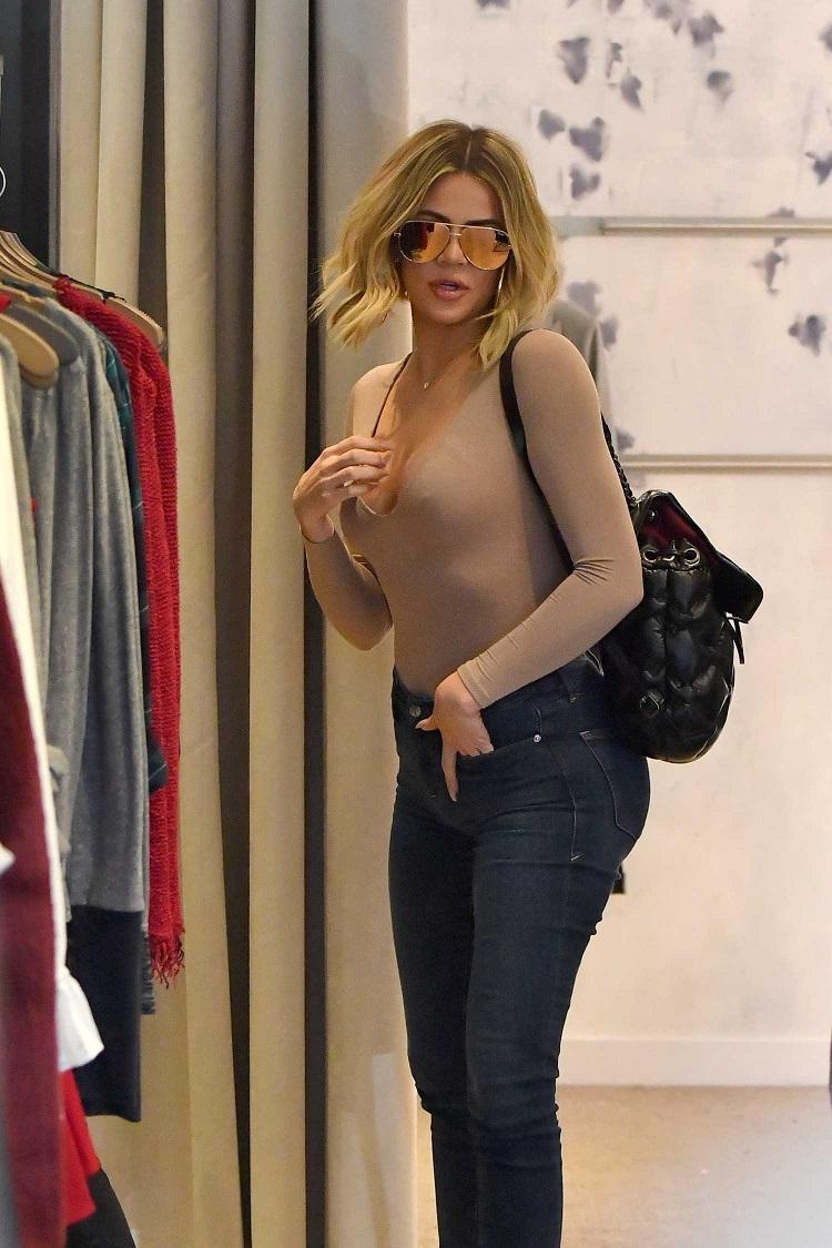 Khloe Kardashian goes braless in nude leotard and jeans in LA