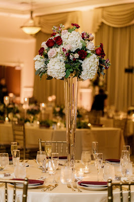 tall floral centerpieces at reception